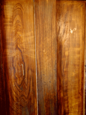 Damaged faux walnut woodgrain ready for restoration.