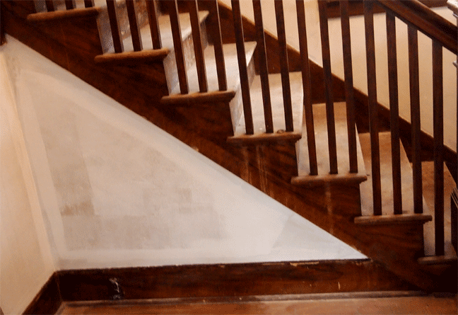 Faux walnut woodgrain stair skirt and base boards damage